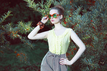 opulent: Charisma. Individuality. Luxurious Woman in Fancy Sunglasses Outside Stock Photo