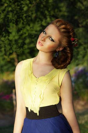 sundress: Cute Romantic Young Woman in Sleeveless Sundress Outdoors Stock Photo