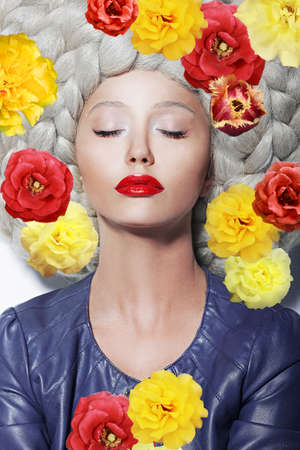Fantasy  Portrait of Sleeping Woman with Closed Eyes and Colorful Flowers photo