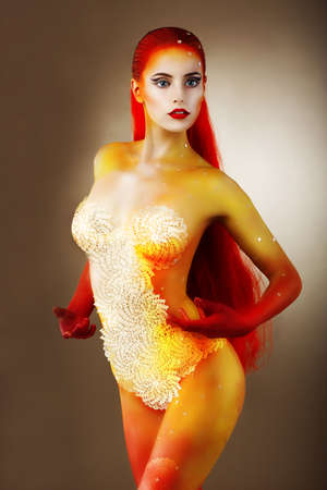 Bodypainting. Graceful Naked Woman with Colored Skin photo