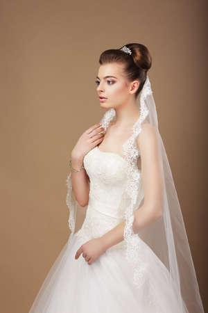 Espousal. Profile of Elegant Stylish Bride with Veil photo