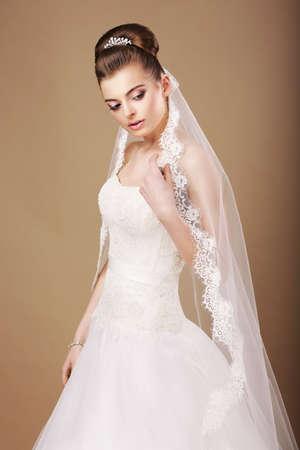 Femininity. Sentimental Bride in White Dress and Openwork Veil