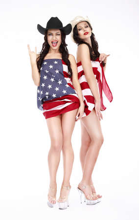 Glamorous Lucky Females in Hats and American Flag posing Stock Photo