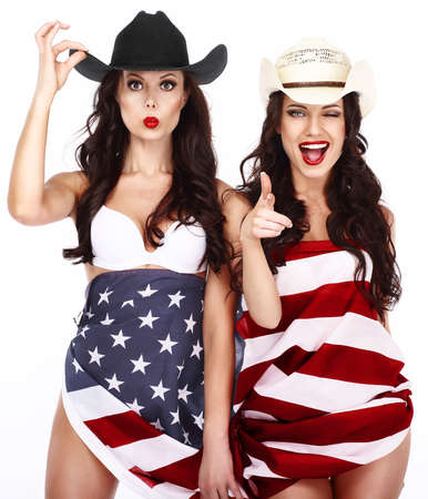 Two Ecstatic Showy Women Wrapped in USA Flag photo