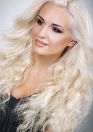 waved: Classy Glamorous Blonde with Waved and Frizzy Hair