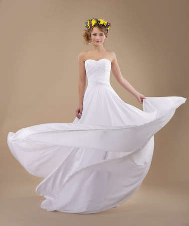Motion  Woman with Wreath of Flowers and Fluttering Light Dress photo