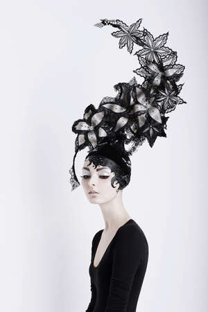 Creative Concept  Portrait of Futuristic Woman in Art Fabulous Headdress Stock Photo