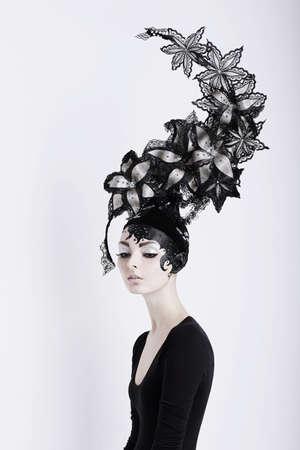 model art: Creative Concept  Portrait of Futuristic Woman in Art Fabulous Headdress Stock Photo