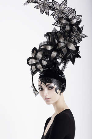 gray hair: Stylish Eccentric Woman with Fanciful Make-up and Outlandish Hat Stock Photo