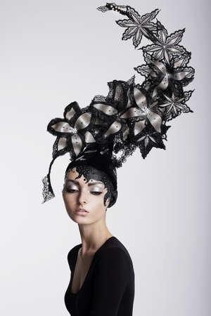 surrealism: Fantasy  Surrealism  Amazing Woman in Trendy Headwear with Flowers