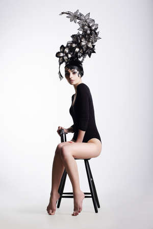 extraordinary: Artistic Fancy Woman wearing Extraordinary Fancy Headdress Stock Photo