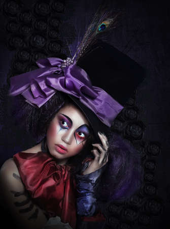 Clown in Fancy Carnival Hat with Artistic Makeup photo
