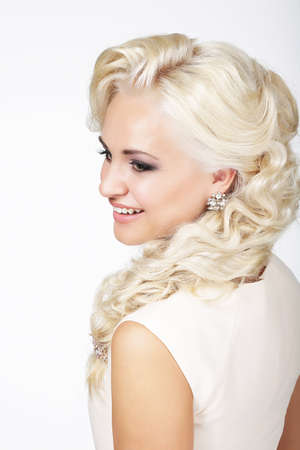 plait: Portrait of Smiling Fashionable Blond Hair Woman with Plait Stock Photo