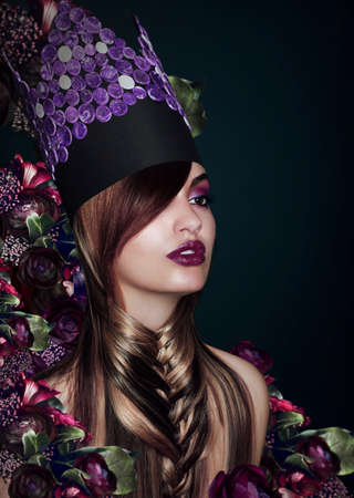 Outlandish Fashion Model in Theatrical Colorful Hat photo