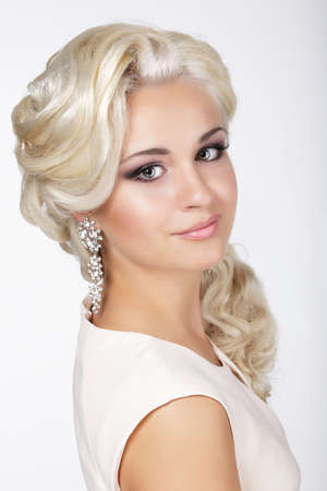 groomed: Elegance. Confident Groomed Blonde with Costume Jewelry Stock Photo