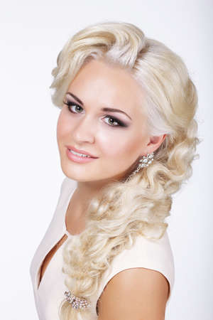 platinum hair: Sophisticated Classy Blond with Silver Earrings Stock Photo