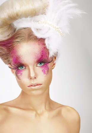 showy: Showy Woman with Fuzzy Feathers and Fantastic Art Makeup