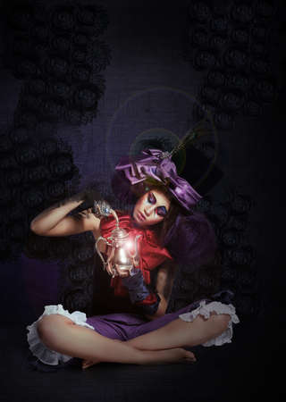 Witchcraft. Fairytale. Enigmatic Magus with Lamp in Darkness