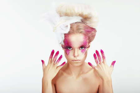 smeared: Creative Makeup. Outre Womans Spotted Face and Stained Fingernails