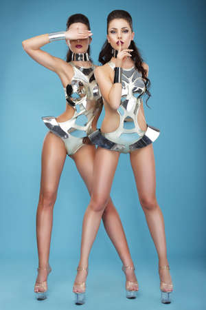 persona: Extravagance  Two Heeled Women in Futuristic Clubwear  Hangouts Stock Photo