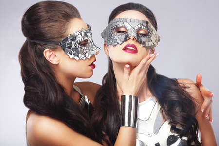Performance. Entertainment. Women in Silver Shiny Masks. Artistry photo