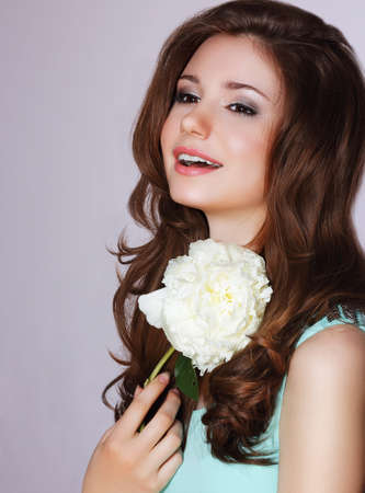goodly: Freshness. Happy Woman with Peony Flower Smiling Stock Photo