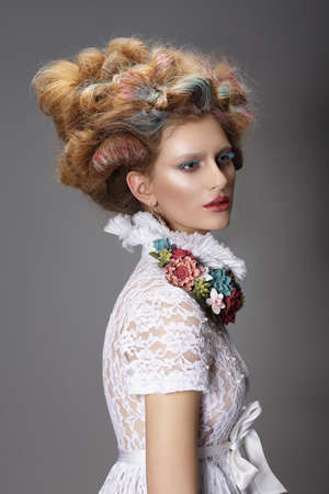 Updo. Dyed Hair. Woman with Modern Hairstyle. High Fashion photo