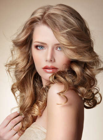 frizzy: Sophisticated Woman with Perfect Skin and Flowing Blond Healthy Hair