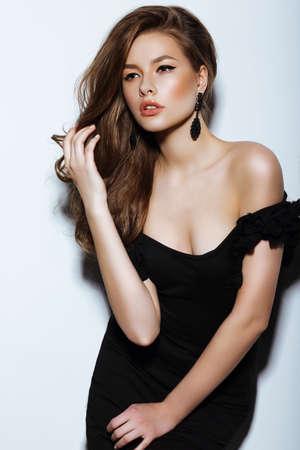 Individuality. Thoughtful Elegant Lady in Black Prom Dress photo