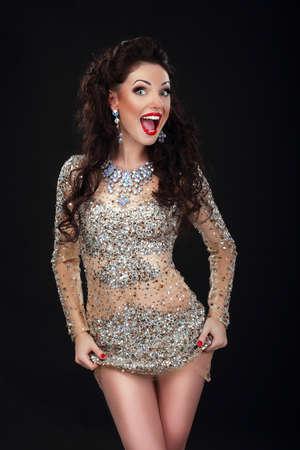 stagy: Cheerful Woman in Shiny Silver Stagy Dress Having Fun