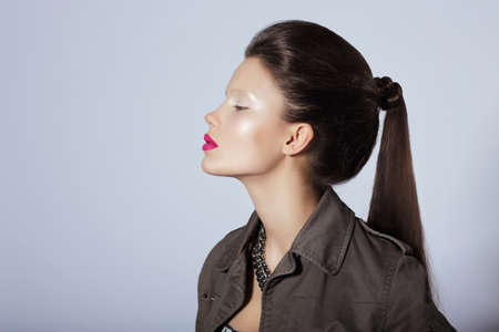 tress: Beauty. Profile of Young Stylish Brunette with Tress