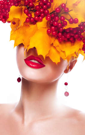 Fall. Woman with Wreath of Maple Leaves and Berries photo