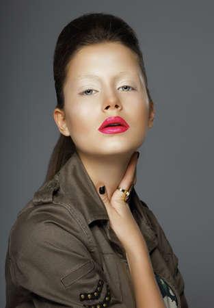 upsweep: Elegance. Asian Woman with Trendy Makeup