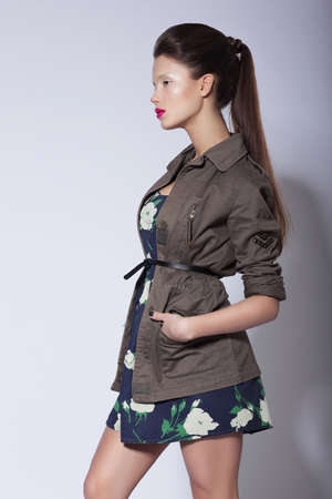 stylishness: Stylishness. Fashionable Woman posing in Elegant Coat