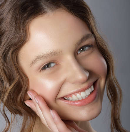 sincere: Sincere Winning Smile. Face of Happy Pleasant Young Woman Stock Photo
