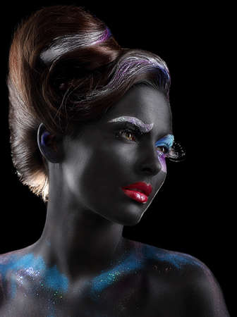 Body-painting. Fantasy. Woman with Fantastic Stagy Makeup over Black photo