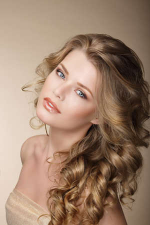 Pure Beauty. Exquisite Woman with Perfect Curly Ash-Colored Hair photo