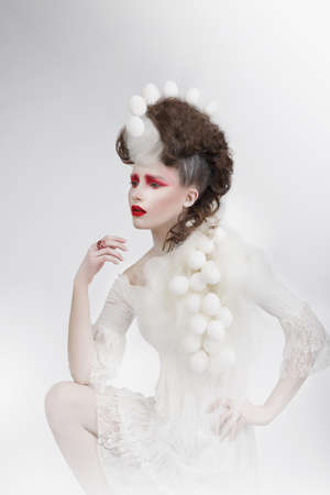 Woman with Eggshells and Art Fancy Makeup photo