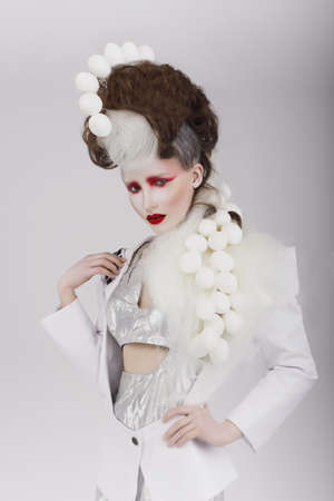 haute: Extravagant Woman in Cyber Costume and Theatrical Hair-do Stock Photo