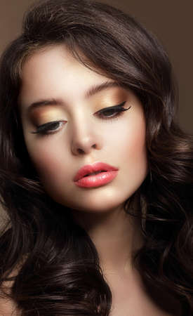 Pure Beauty. Portrait of Young Brunette with Glossy Makeup photo