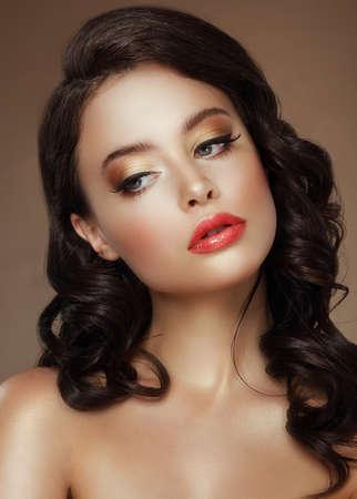 Visage. Evening Makeup. Stylish Woman with Golden Eyeshadows photo