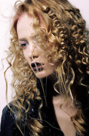charisma: Charisma. Individuality. Young Woman with Curly Hairs