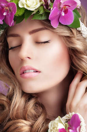 Pleasure. Face of Daydreaming Woman with Vernal Flowers photo