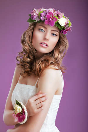 exquisite fairy: Exquisite Woman with Wreath of Flowers. Elegant Lady with Frizzy Hair Stock Photo
