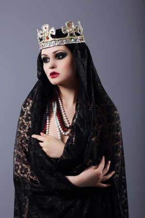magus: Witchcraft. Woman in Old-Fashioned Clothes and Crown Stock Photo