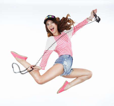 kepi: Lifestyle. Dynamic Animated Funny Woman Jumping. Freedom Stock Photo