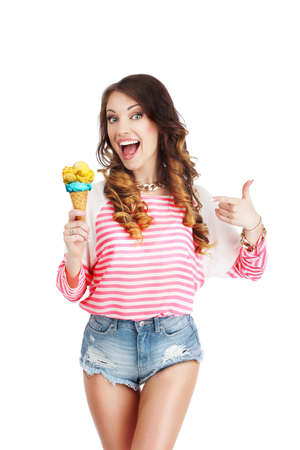 woman eating cake: Gladness. Delightful Woman with Ice Cream Laughing