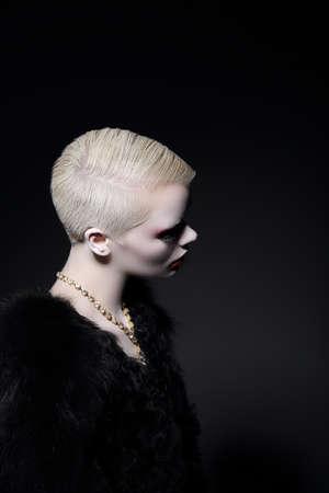 charisma: Charisma. Profile of Blonde Fashion Model with Bob Hairdo