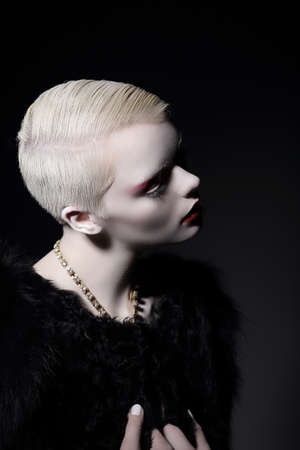short haircut: Individuality. Glamorous Well-dressed Blond Woman with Short Haircut Stock Photo