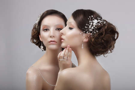 stagy: Vogue Style. Two Snazzy Women with Jewelry and Art Make-up Stock Photo